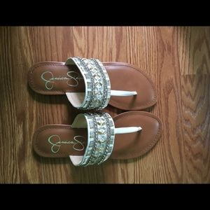 JS sandals never worn. In fantastic condition.